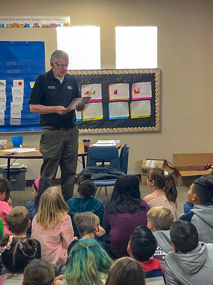Councilmember Remley reads to students as a part of Read Across America Day