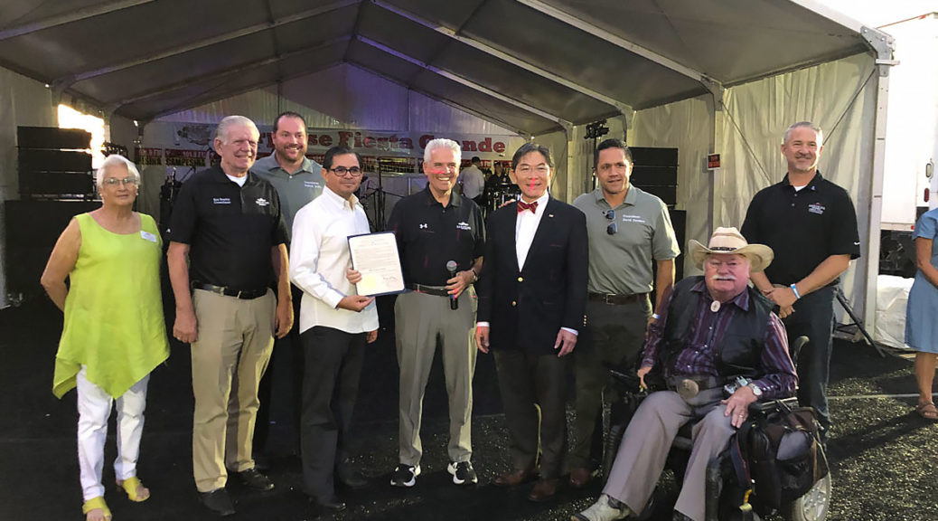 Mayor Hall holds the proclamation presented by Barry Wong at Surprise Fiesta Grande.