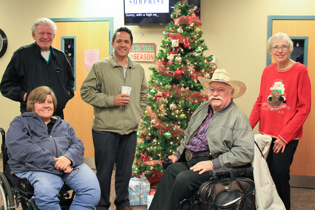 Councilmembers Remley, Sanders and Vice Mayor Winters in front of the Christmas Tree at the Deck the Hock event.