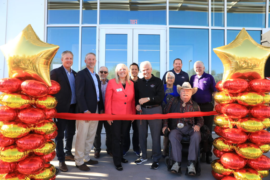 Mayor Hall, Congresswoman Debbie Lesko and Surprise City Councilmembers prepare to cut a grand opening ribbon.
