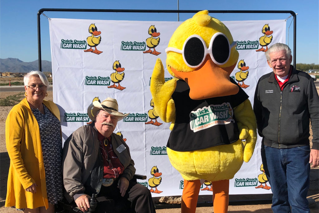 Councilmember Hayden, Councilmember Winters, Councilmember Remley and the Quick Quack Car Wash mascot.