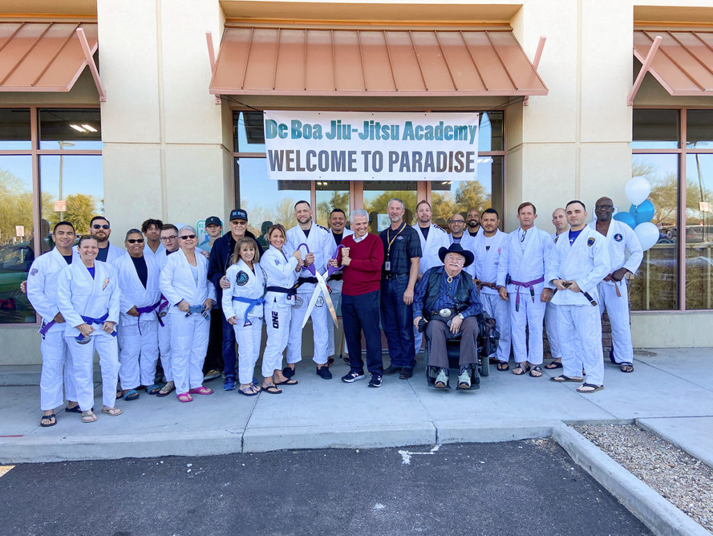 Mayor Hall, Vice Mayor Judd, Councilmember Winters and the employees of De Boa Jiu-Jitsu Academy stand outside the business for the grand opening ceremony.