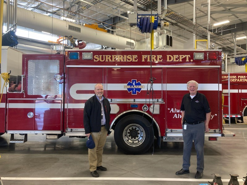 Councilman Remley stands next to a surprise Fire Department truck inside the new Surprise public works facility.